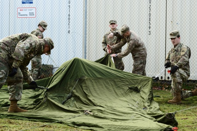 Oregon Army National Guard Sgt. Paul Mannelly (center), alongside fellow Soldiers with 2nd Battalion, 162nd Infantry Regiment, 41st Infantry Brigade Combat Team, gives instructions as they practice setting up a Canadian Army Reserve tent kit in preparation for the Westie Avalanche Exercise, Jan. 25, 2019, at the Chilliwack Armoury, in Chilliwack, British Columbia, Canada.