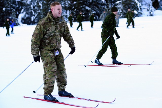 Oregon Army National Guard Staff Sgt. Eric Givens, with Delta Company, 2nd Battalion, 162nd Infantry Regiment, 41st Infantry Brigade Combat Team, races with Canadian Army Reserve Cpl. Franklin Pengelly (right), with Alpha Company, Royal Westminster Regiment, 39th Canadian Brigade Group, as they learn to cross-country ski during Westie Avalanche Exercise, Jan. 26, 2019, at E.C. Manning Park, British Columbia, Canada.