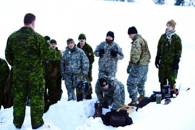 Oregon Army National Guard Soldiers with 2nd Battalion, 162nd Infantry Regiment, 41st Infantry Brigade Combat Team, and Canadian Army Reserve Soldiers with the Royal Westminster Regiment, 39th Canadian Brigade Group, learn techniques for building snow shelters from instructors with the 4th Canadian Rangers Patrol Group during Westie Avalanche Exercise, Jan. 26, 2019, at E.C. Manning Park, British Columbia, Canada.