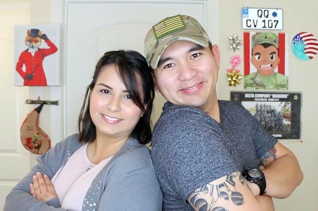 "Staff Sgt. Archie Masibay poses for a photo with his wife, Flor. Serving as a recruiter in Brentwood, Calif., Masibay, also known as ARCHIEzzle, highlights Army topics that inform, entertain, and motivate others. And while ""Archiezzle"" is just an online persona, Masibay interacts with his YouTube and other social media community to answer questions potential recruits may have before joining the Army."