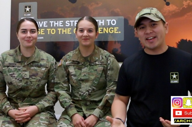 Staff Sgt. Archie Masibay discusses Army combat medic training with two recent AIT graduates. Serving as a recruiter in Brentwood, Calif., Masibay, also known as ARCHIEzzle, interacts with his YouTube and other social media community to answer questions potential recruits may have before joining the Army.