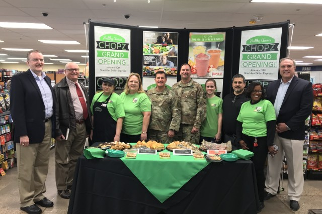 The Fort Sill Garrison command team stand with Chopz staff and managers, and AAFES personnel at the grand opening of Chopz Jan. 30, 2019, inside the Sheridan Express here.