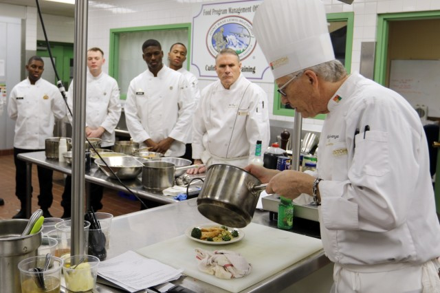 The Adopt an Installation culinary program brings civilian executive chef expertise to Army training. Chef Mike Speranza, executive corporate chef with Custom Culinary of Rochester, N.Y., demonstrates effective methods of food presentation to culinary Soldiers, during a training session on Joint Base Lewis-McChord.