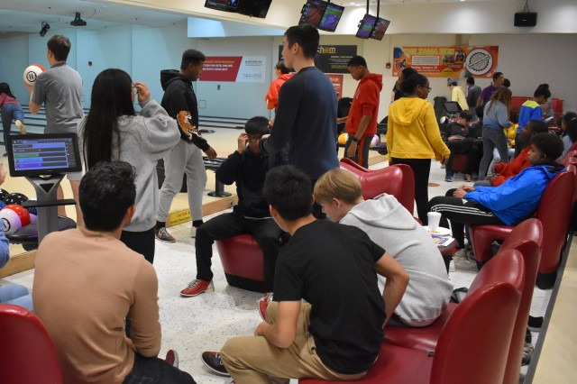 """About 80 students from Zama Middle High School packed the Camp Zama Bowling Center Feb. 6, 2019, for the """"Strike Out Teen Dating Violence"""" event."""