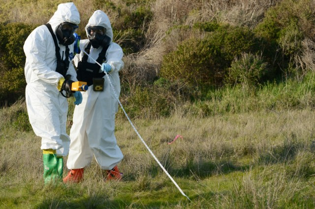 Oregon Army National Guardsmen assigned to the 102nd Civil Support Team (CST) search a training area testing and mark off sections for unknown chemical agents at Fort Baker, Golden Gate National Recreation Area, San Francisco, California, Jan. 30, 2019. National Guard civil support teams worked with local agencies, including the San Francisco Fire Department, other first responders to assess and respond to a series simulated chemical attacks around the San Francisco Bay area as part of BAYEX, a week-long training exercise designed to bring multiple response agencies together to enhance interoperability during large-scale disasters.