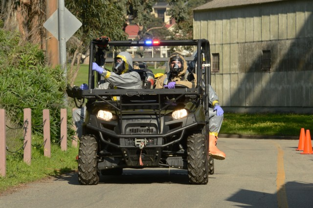 A team of first responders from the California and Oregon National Guard Civil Support Teams (CST) moves into a training area at Fort Baker, Golden Gate National Recreation Area, San Francisco, California, Jan. 30, 2019. National Guard civil support teams worked with local agencies, including the San Francisco Fire Department, other first responders to assess and respond to a series simulated chemical attacks around the San Francisco Bay area as part of BAYEX, a week-long training exercise designed to bring multiple response agencies together to enhance interoperability during large-scale disasters.