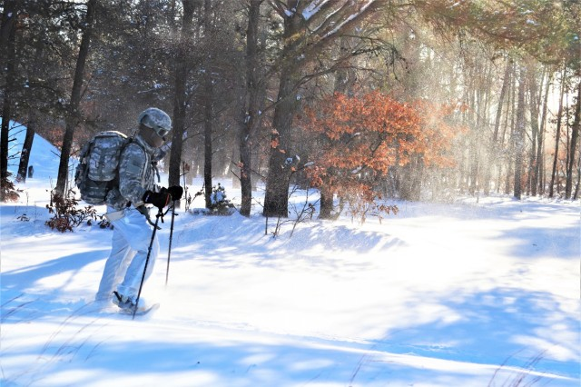 A student in Cold-Weather Operations Course (CWOC) Class 19-03 completes a ruck march in below-zero temperatures while wearing snowshoes and a backpack Jan. 29, 2019, at Fort McCoy, Wis. CWOC students are trained on a variety of cold-weather subjects, including snowshoe training and skiing as well as how to use ahkio sleds and other gear. Training also focuses on terrain and weather analysis, risk management, cold-weather clothing, developing winter fighting positions in the field, camouflage and concealment, and numerous other areas that are important to know in order to survive and operate in a cold-weather environment. The training is coordinated through the Directorate of Plans, Training, Mobilization and Security at Fort McCoy. (U.S. Army Photo by Scott T. Sturkol, Public Affairs Office, Fort McCoy, Wis.)