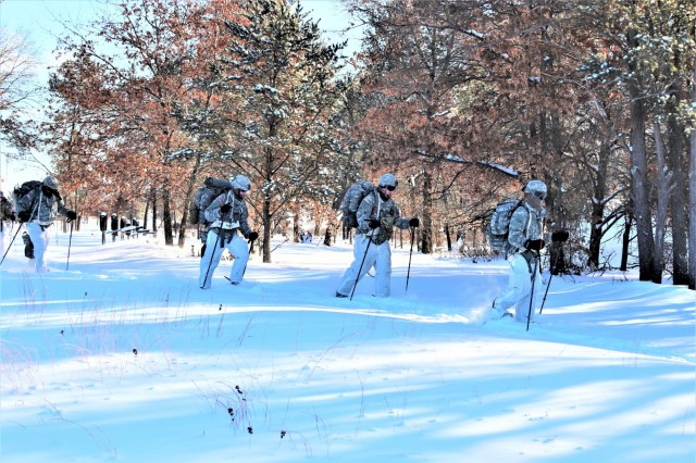 Students in Cold-Weather Operations Course (CWOC) Class 19-03 complete a ruck march in below-zero temperatures while wearing snowshoes and backpacks while pulling ahkio sleds Jan. 29, 2019, at Fort McCoy, Wis. CWOC students are trained on a variety of cold-weather subjects, including snowshoe training and skiing as well as how to use ahkio sleds and other gear. Training also focuses on terrain and weather analysis, risk management, cold-weather clothing, developing winter fighting positions in the field, camouflage and concealment, and numerous other areas that are important to know in order to survive and operate in a cold-weather environment. The training is coordinated through the Directorate of Plans, Training, Mobilization and Security at Fort McCoy. (U.S. Army Photo by Scott T. Sturkol, Public Affairs Office, Fort McCoy, Wis.)