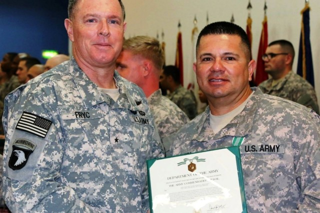 Brig. Gen. Donald G. Fryc, 32nd AAMDC Commander presents Sgt. 1st Class Esteban Sepulveda with the Army Accommodation Award, February 2015.   (Photo Courtesy of Sgt. 1st Class Esteban Sepulveda)