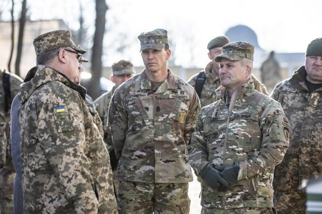 From left: Ukrainian General Pavel Tkachuk, Command Sgt. Maj. of U.S. Army Europe, Command Sgt. Maj. Rob Abernethy and U.S. Army Europe Commanding Officer, Lt. Gen. Christopher Cavoli talk during their visit to Yavoriv, Ukraine, Feb. 8.