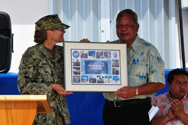 SAIPAN, Commonwealth of the Northern Mariana Islands (Feb. 6, 2019) - Rear Adm. Shoshana Chatfield, commander, Joint Region Marianas and commander, Joint Task Force West commander, presents a gift to Saipan Mayor David Apatang during the closing ceremony for Joint Task Group Engineer in Saipan, CNMI, Feb. 6.  The ceremony was held to mark the end of Department of Defense relief and recovery efforts in support of the Federal Emergency Management Agency and CNMI's civil and local authorities from the devastating impacts of Super Typhoon Yutu, which hit the commonwealth Oct. 25, 2018. (U.S. Army photo by Sgt. 1st Class Wynn Hoke)