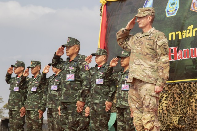 Col. Chitsanupong Rodsiri, the Deputy Commanding General for 2nd Infantry Division King's Guard, Royal Thai Army, and Brig. Gen. Joel Vowell, the 25th Infantry Division Deputy Commanding Officer-Operations, salute as the national anthems of the U.S. and Thailand are played during the Hanuman Guardian closing ceremony, Feb. 7, 2019, at Camp Nimman Kolayut, Thailand. Hanuman Guardian 2019 was a training exercise with the Royal Thai Army designed to enhance military-to-military partnerships, interoperability and mission readiness.
