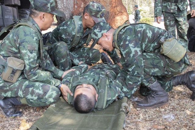 Royal Thai Army soldiers render care to a simulated casualty during a subject matter expert exchange, Feb. 1, 2019, at Camp Nimman Kolayut, Thailand. This was during Hanuman Guardian, a training exercise designed to increase readiness, interoperability and collaboration between the U.S. and Thai militaries in order to achieve effective solutions to common challenges. (U.S. Army photo by Staff Sgt. Samuel Northrup)