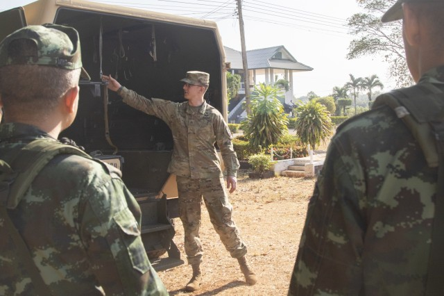 A noncommissioned officer with C Company, 296th Brigade Support Battalion, describes the features of a field litter ambulance to Royal Thai Army soldiers, Feb. 1, 2019, at Camp Nimman Kolayut, Thailand. This was during Hanuman Guardian, a training exercise designed to increase readiness, interoperability and collaboration between the U.S. and Thai militaries in order to achieve effective solutions to common challenges. (U.S. Army photo by Staff Sgt. Samuel Northrup)