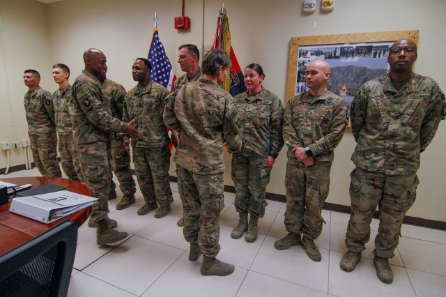 "Col. Stephanie Barton, the brigade commander of the 101st Resolute Support Sustainment Brigade, and her senior enlisted advisor Command Sgt. Maj. Anthony McAdoo present coins of excellence on behalf of Maj. Gen. Flem B. ""Donnie"" Walker Jr., the commanding general of the 1st Theater Sustainment Command, to eight Lifeliner's Soldiers who distinguished themselves by going above and beyond during their nine-month deployment to Bagram Airfield, Afghanistan in direct support of Operation Freedom's Sentinel and U.S. Forces Afghanistan. (U.S. Army photo by Staff Sgt. Caitlyn Byrne)"