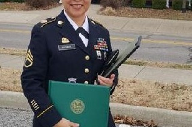 Staff Sgt. Mhalyn Nanquil, Philippine native, formally of the 348th Composite Supply Company, 194th Combat Sustainment Support Battalion, 2nd Sustainment Brigade, 2nd Infantry Division, now assigned to 304th Signal Battalion, 1st Signal Brigade, 8th Army, poses for a photo after her graduation ceremony December 14th, 2018. Nanquil graduated the course with a academic average of 98.96%. (U.S. Army Courtesy Photo)