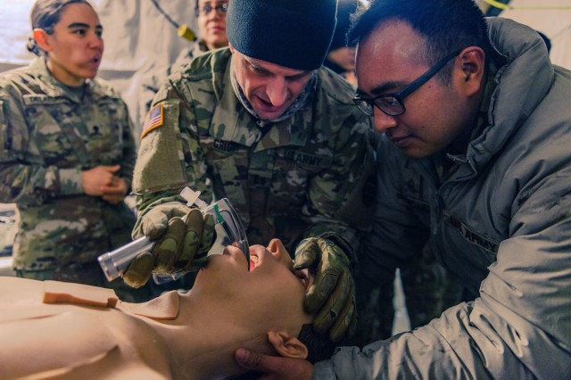 Idaho Army National Guard Capt. Jake Griggs, physician assistant, trains enlisted Soldiers how to intubate a patient  Feb. 9, 2019, at the Orchard Combat Training Center. Charlie Company, 145th Brigade Support  Battalion hosted the event to synchronize and coordinate the 116th Calvary Brigade Combat Team's medical support for its upcoming rotation at the National Training Center, Fort Irwin, Calif.