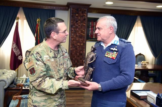 Air Force Gen. Joseph Lengyel, chief, National Guard Bureau, presents a Minuteman, the symbol of the Guard, to Maj. Gen. Yousef Al-Hnaity, commander, Royal Jordanian Air Force, during a visit to the Hashemite Kingdom of Jordan, Feb. 7, 2019.