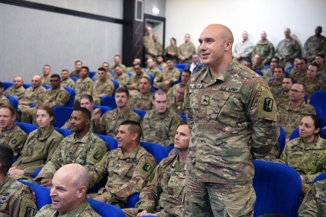 A Soldier asks a question at a town hall meeting with Air Force Gen. Joseph Lengyel, chief, National Guard Bureau, during the general's visit to the Hashemite Kingdom of Jordan, Feb. 7, 2019.