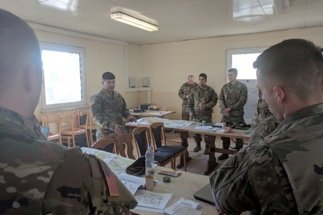 Capt. Matthew Scrivner, commander, Bravo Troop, Regimental Engineer Squadron, 2d Cavalry Regiment, teaches a group of students about the four different obstacle effects during the Task Force Engineer Academy at Camp Aachen, Germany, March 20 - 23, 2018.
