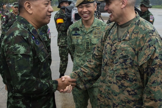 190212-N-ZH960-1596 Phitsanulok, Kingdom of Thailand (12 February, 2019) - Maj. Gen. Apichet Suesat, 4th Infantry Division Commanding General, Royal Thai Army, greets Brig. Gen. Sean M. Salene, assistant wing commander, 1st Marine Aircraft Wing,  during the opening ceremony of exercise Cobra Gold 19 at Phitsanulok, Kingdom of Thailand, Feb. 12, 2019. Cobra Gold is one of the largest theater security cooperation exercises in the Indo-Pacific and is an integral part of the U.S. commitment to strengthen engagement in the region. Cobra Gold 19, the 38th iteration of this exercise, emphasizes coordination on civic action, such as humanitarian assistance and disaster relief, seeking to expand regional cooperation and collaboration in these vital areas. (U.S. Navy Photo by Mass Communication Specialist 2nd Class Andrew P. Holmes / Released)