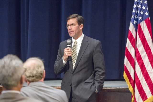 "Secretary of the Army Mark T. Esper says the service must modernize or ""risk losing the first fight of the next war."" He spoke on a panel with his counterparts from the Navy and Air Force at the Center for Strategic and International Studies in Washington, D.C., Feb. 8, 2019. Pictured here, Secretary Esper addresses members of the Picatinny Arsenal workforce during a visit on Aug. 26, 2018."