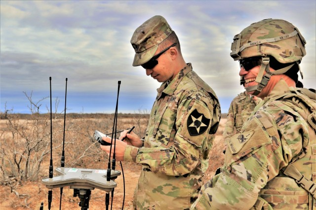 The new electronic warfare modernized equipment has many parts, some which are already fielded in the Army, and requires teams in order to be fully effective. Staff Sgt. Brett McCaskill, assigned to 2nd Brigade, 2nd Infantry Division, and Sgt. 1st Class Ryan Beach, with 2nd Armored Brigade Combat Team, 1st Armored Division, are in a team to locate and decipher enemy frequencies from a one known location.
