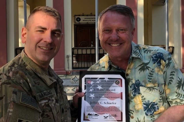 District Deputy Commander, Lt. Col. Mike Harding presents Jeff Schaefer with his A-Team Award.