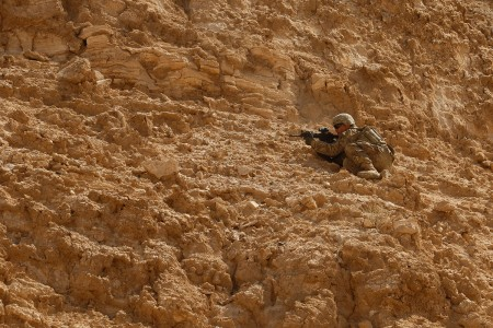A Mississippi National Guard Soldier readies his position for cover fire as a part of team movement drills through a wadi in Rabkoot, Oman, Jan. 28, 2019. 'Wadi' translates to 'valley' from Arabic to English. The U.S. Army and the Royal Army of Oman are spending days in a wadi system conducting team, squad, and platoon maneuvers during exercise Inferno Creek 19. The bilateral exercise was designed to strengthen relations between the two militaries.