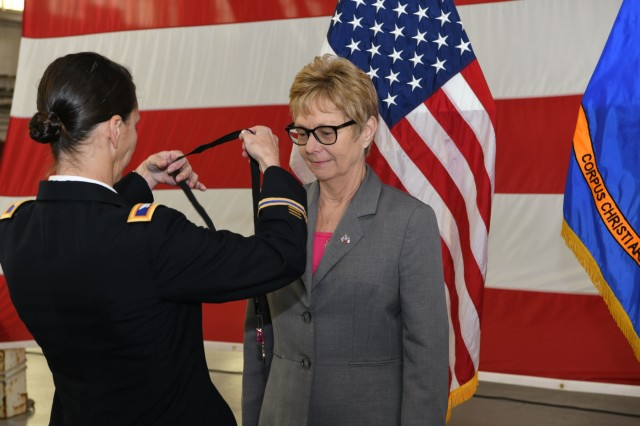 CORPUS CHRISTI ARMY DEPOT, Texas - Colonel Gail Atkins, commander, Corpus Christi Army Depot, presents Annette Cross, CCAD chief of staff, with the Army's Superior Civilian Service Award during her retirement ceremony, here, February 1, 2019. Cross retired as the after 31 years of federal service, all of which were served at the depot. Cross managed multiple aspects of the depot, which employs more than 3200 civilians, contractors and military members.