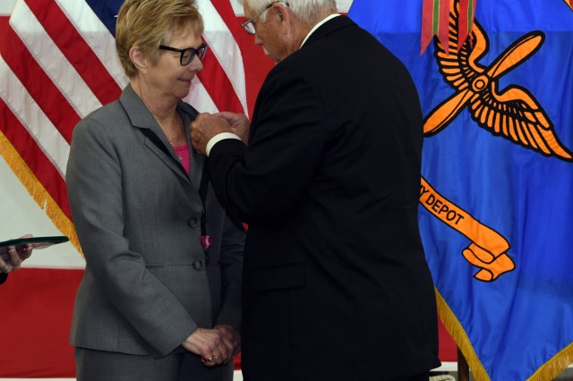 CORPUS CHRISTI ARMY DEPOT, Texas - Mike Cross pins his wife, Annette, with her retirement pin during her retirement ceremony, here, February 1, 2019. Cross retired as the CCAD chief of staff after 31 years of federal service, all of which were served at the depot. Cross managed multiple aspects of the depot, which employs more than 3200 civilians, contractors and military members.