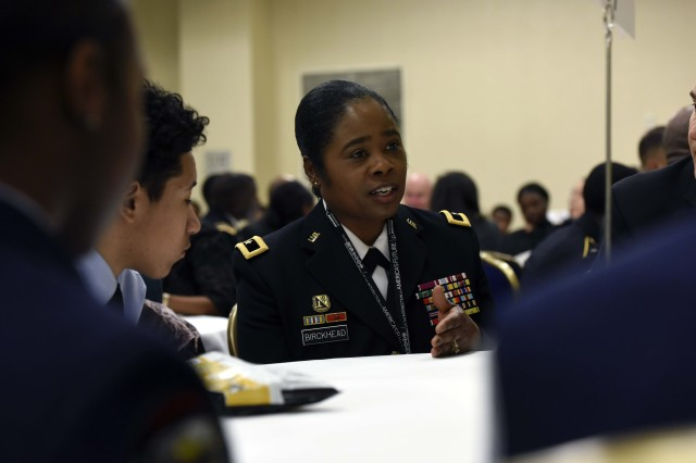 Army Brig. Gen. Janeen Birckhead, the Maryland National Guard's assistant adjutant general for Army, illustrates a point to high school and college students during a mentoring session that was part of the annual Black Engineer of the Year Awards, Science, Technology, Engineering and Mathematics, Global Competitiveness Conference, held recently in Washington, D.C. Birckhead highlighted to the students how STEM can be a viable career option for them, as well as discussing how it's part of their day-to-day lives.