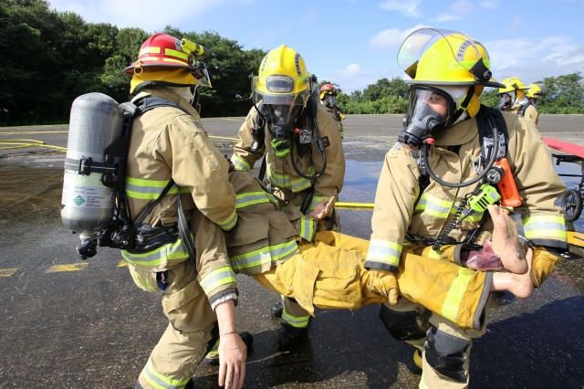 Camp Zama firefighters practice emergency services during a full-scale exercise at Camp Zama Aug. 21, 2018. USAG Japan Fire and Emergency Services is the 2018 Installation Management Command-Pacific Fire Department of the Year -- Large Category.