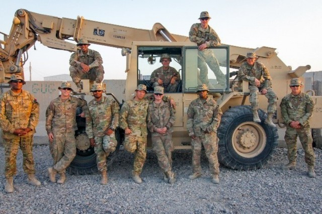 Soldiers assigned to the 10th Mountain Division, 2-14 Infantry Regiment, Golf Forward Support Company end their day at the distribution yard where they manifest, stage, and load all fixed wing resupplies that is delivered across the southern and western regions of Afghanistan on Kandahar Airfield