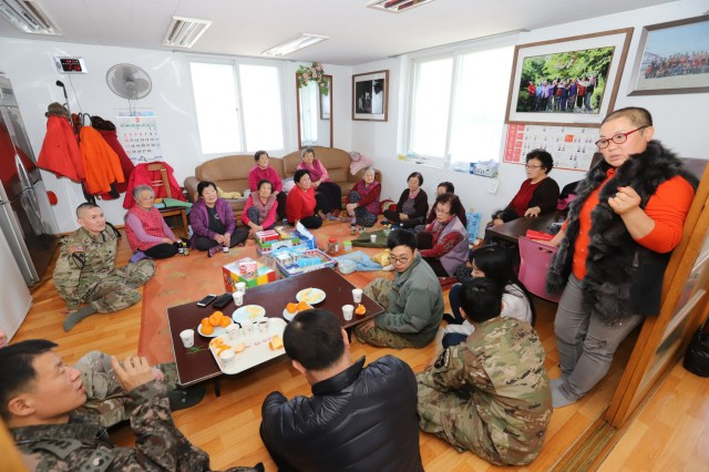 POCHEON, Republic of Korea - Ms. Choi, Myung-Sook (first person from the right), chairperson, Yami Senior Community Center, shares her past experience with the 2nd Infantry Division as a local resident during 2ID/RUCD's visit, Feb. 13. The division was there in support of the U.S. Forces Korea Good Neighbor Program which aims to promote friendship, trust and mutual understanding between USFK service members and the Republic of Korea citizens through volunteer service and activities. (U.S. Army photo by KATUSA Cpl. Park, Seung Ho, 2ID/RUCD Public Affairs)