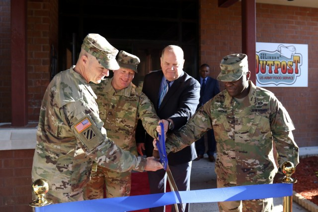 From left, Col. Jeffrey Britton, the 3rd Infantry Division Sustainment Brigade commander, Command Sgt. Maj. Toby Grisham, the senior enlisted advisor for 3rd Inf. Div. Sust. Bde., David Staples, the director of operations for the Army Center of Excellence, Subsistence, and Chief Warrant Officer 5 Kenneth Hicks, the Army food advisor for the Sustainment Center of Excellence, cut the ribbon during the grand opening of the Culinary Outpost Kiosk, Feb. 4, 2019 at Ft. Stewart, Ga. The food kiosk, first of its kind for DLA and the Army, symbolizes the innovation and modernization efforts of the Army's food program. (U.S. Army photo by Sgt. Elizabeth White/Released)