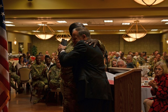 Retired Chaplain (Maj. Gen.) Douglas Carver, executive director of Chaplaincy for the Southern Baptist Convention's North American Mission Board, gets a hug from Chaplain (Col.) Milton Johnson, Fort Jackson command chaplain, prior to Carver's presentation during the 2019 National Prayer Breakfast Feb. 7 at the NCO Club.