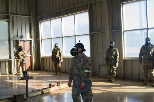 Sgt. 1st Class Lisa S. Smith, senior CBRN noncommissioned officer, HHC, 13th ESC, instructs sustainers on how to ensure their M50 masks are properly sealed at Fort Hood, Texas, Jan. 17. Known as the confidence course, the CBRN chamber allowed the Soldiers to test the capabilities of their assigned M50 protective masks and learn CBRN warrior skills level one tasks.