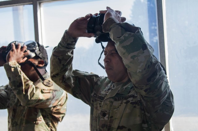 Soldiers break the seal on their M50 protective masks before re-sealing them at Fort Hood, Texas, Jan. 17, Soldiers gained familiarity with their protective equipment, and learned warrior skills one level tasks.