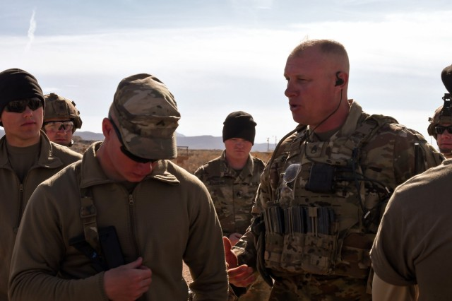 Staff Sgt. Jason Staats (right), an infantryman for Bravo Company, 2nd Battalion, 127th Infantry Regiment, Wisconsin Army National Guard, gives a mission brief to his Soldiers prior to the company's guardian angel squad training exercises conducted at the McGregor Range Complex, N.M., Feb. 9, 2019. The company has been taking part in guardian angel STXs to augment their readiness and lethality capabilities, preparing them for advise and assist missions in their imminent overseas mobilization.