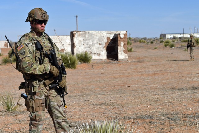 Sgt. Richard Anderson, an infantryman for Bravo Company, 2nd Battalion, 127th Infantry Regiment, Wisconsin Army National Guard, conducts perimeter security with other Soldier during the company's guardian angel squad training exercises conducted at the McGregor Range Complex, N.M., Feb. 9, 2019. The company has been taking part in guardian angel STXs to augment their readiness and lethality capabilities, preparing them for advise and assist missions in their imminent overseas mobilization.