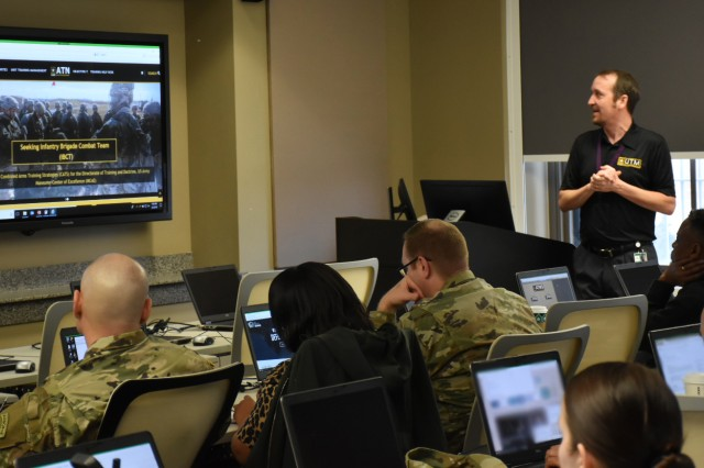 Phillip Hobbs, Training Management Directorate Mobile Training Team, instructs students during a Digital Training Management System Managers Course.