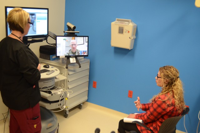 Lt. Col. Jennifer Huxel, chief of inpatient nursing, Irwin Army Community Hospital, speaks with her allergy doctor via the new Virtual Health option where patients video conference with a health provider at other installations.