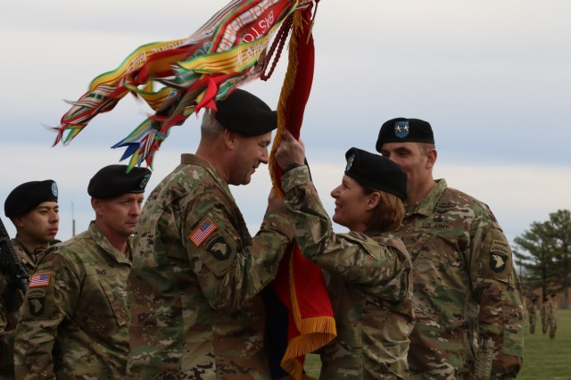 "Lt. Gen. Laura Richardson, acting commanding general for U.S. Forces Command, hands the ""Screaming Eagle"" colors to Maj. Gen. Brian Winski, as he assumes command of the 101st Airborne Division (Air Assault), Feb. 14, at Fort Campbell, Kentucky. Winski succeeds Maj. Gen. Andrew Poppas, who, after commanding the world's only air assault division for the past two years, will move on to the Pentagon, as the director of operations for the Joint Staff."