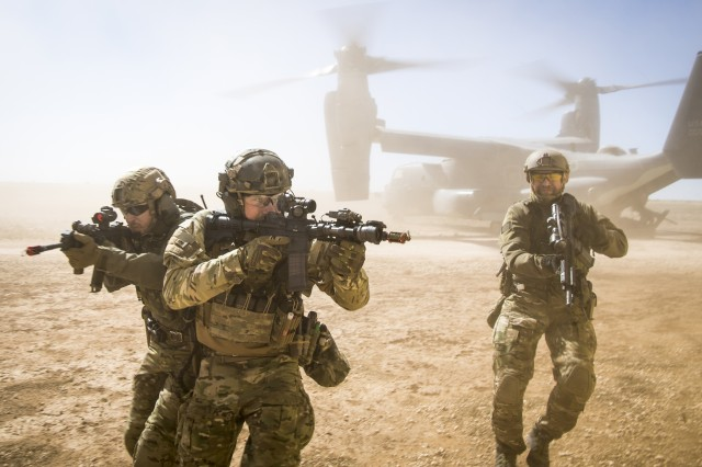 A joint special forces team move together out of a U.S. Air Force CV-22 Osprey Feb. 26, 2018, at Melrose Training Range, N.M. At Emerald Warrior, the largest joint and combined special operations exercise, U.S. Special Operations Command forces train to respond to various threats across the spectrum of conflict.