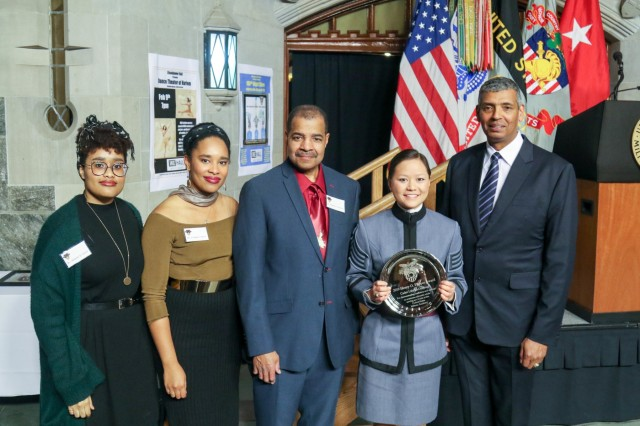 """Class of 2019 Cadet Lilly """"Da Yan Zi"""" McDonough, the recipient of the 2019 Flipper Award,  is joined by retired Gen. Vincent K. Brooks, Class of 1980, and Flipper's decendents Ashanti D. Davis, D'Asha A. Davis and Kenneth C. Davis during the Henry O. Flipper Commemoration Dinner at the Cadet Mess Hall Feb. 8, 2019.  (U.S. Army Photo by Brandon O'Connor)"""