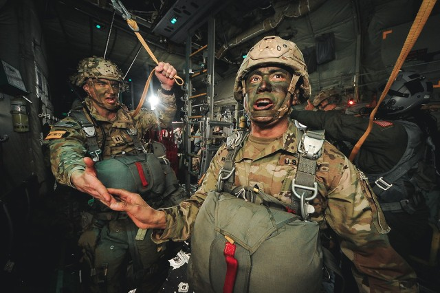 "Command Sgt. Maj. Delfin J. Romani of the 54th Brigade Engineer Battalion, 173rd Airborne Brigade, receives his last ""All OK Jumpmaster!"" during an airborne operation in northern Italy, Jan. 31, 2019."