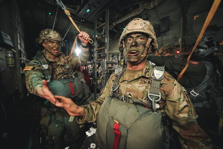 """Command Sgt. Maj. Delfin J. Romani of the 54th Brigade Engineer Battalion, 173rd Airborne Brigade, receives his last """"All OK Jumpmaster!"""" during an airborne operation in northern Italy, Jan. 31, 2019."""