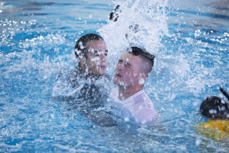 """In the thick heat of a Missouri summer, the number of Army Engineer Dive School dropouts rises faster than the steamy temperature.""""Does anyone want to DOR (drop out on request)?"""" said Staff Sgt. Andrew Holdner, as Soldiers in soaked combat uniforms push through the pool's waters in the early hours of a muggy July morning. Holdner, a diving cadre instructor, looks over at the Soldiers struggling in the pool."""