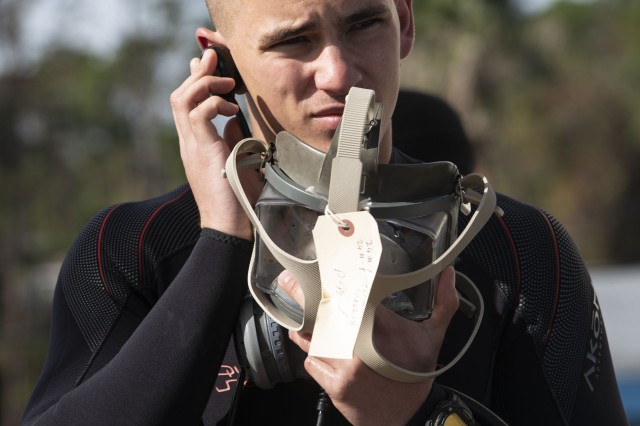 Pfc. Stephen Olinger performs a mask check prior to beginning an exercise at the Naval Diving and Salvage Training Center in Panama City, Fla., in November.